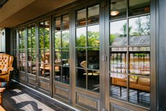 Glazed entrance to the restaurant Royalty Free Stock Image
