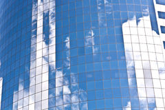 Glazed facade of a modern Skyscraper with reflection of sky Stock Images