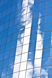 Glazed facade of a modern Skyscraper with reflection of sky Royalty Free Stock Photos