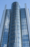Glazed high rise modern office building. Blue Royalty Free Stock Image