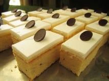 Glazed lemon and poppy seed cake in on shelf in bakery or baker`s shop stock images