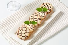 Glazed mini cakes Royalty Free Stock Image