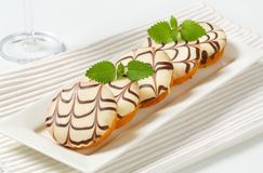 Glazed mini cakes Stock Images