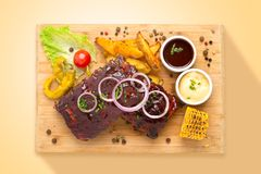 Glazed pork ribs with vegetables. Food from above stock image