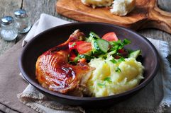 Glazed Roasted Chicken Leg With Mashed Potatoes And Vegetable Salad On A Wooden Background Stock Photos