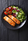 Glazed salmon fillet and fresh vegetable salad close-up on the t Royalty Free Stock Images
