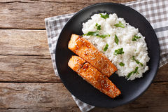 Glazed salmon fillet with rice garnish close-up. horizontal top Royalty Free Stock Photo