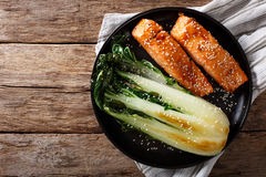Glazed salmon fillet with sesame seeds and roasted cabbage bok c Stock Photography