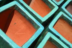 Glazed Terra Cotta Pots. Are featured in an abstract background image Stock Photography