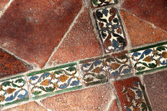 Glazed tiles of an ancient  floor, crossed Stock Images