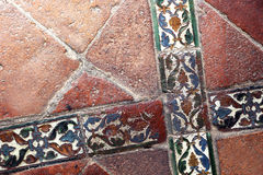 Glazed tiles of an ancient  floor, crossed Royalty Free Stock Images