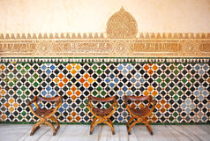 Glazed tiles, azulejos, medieval chairs, Alhambra palace in Granada, Spain Stock Photos