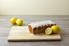 A glazed and unsliced lemon loaf cake Stock Images