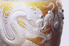 Glazed water jar with silver dragon pattern.  stock images