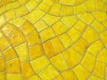 Glazed yellow stone texture Stock Photos