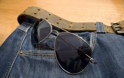 Glazen en jeans Royalty-vrije Stock Afbeeldingen