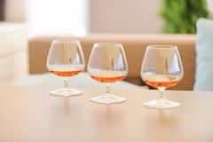 Glazen met Cognac stock foto's