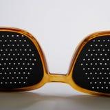 Glazen met een zwarte retina op een lichte achtergrond De banner van het Web stock afbeelding