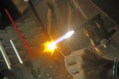Glazier with gas torch lit while blending a piece of glass 1 Stock Images