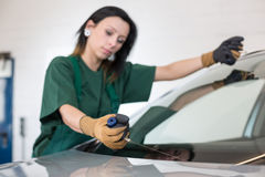 Glazier removing windshield Stock Images