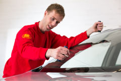 Glazier removing windshield Stock Image