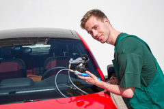 Glazier repairing windscreen after stone chipping damage Royalty Free Stock Photos