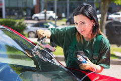 Glazier repairing windscreen after stone chipping damage Stock Image