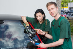Glazier repairing windscreen after stone chipping damage Royalty Free Stock Images
