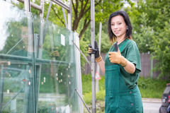 Glaziers loading panes of glass on trailer Stock Image