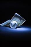 Glazige bol en één dollar Stock Fotografie