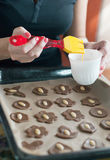Glazing cookies on baking paper in a tray Royalty Free Stock Photography