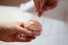 Glazing of a pink muffin. Royalty Free Stock Photo