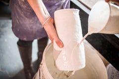 Glazing. A potter glazing a pot Royalty Free Stock Photography