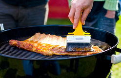 Glazing the ribs Stock Photos