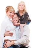 Glückliche Familie über weißem Hintergrund Stockfotos