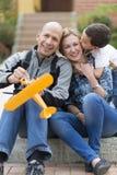 Glückliche Familie und Hobby Stockfotos