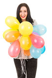 Glückliche Frau, die viele Ballone hält Lizenzfreie Stockfotografie
