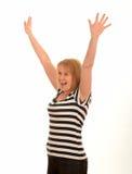 Glückliche Frau mit den Armen in der Luft Stockfoto