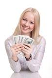 Glückliche Frau mit einem Gebläse des amerikanischen Dollars Stockfotos