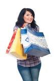 Glückliche Frauenholding-Einkaufenbeutel Stockfotos