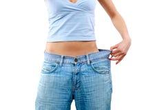 Glückliche junge Frau in den alten Jeans Stockbilder