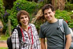 Glückliche junge Kursteilnehmer des Portraits Lizenzfreie Stockfotos