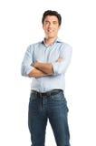 Glückliche junger Mann-Stellung Stockfoto