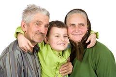 Glückliche ältere Paare mit ihrem Enkel Stockbild