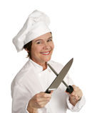 Glücklicher Chef, der Messer schärft Lizenzfreies Stockfoto