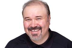 Glücklicher entspannter lächelnder Mann von mittlerem Alter Lizenzfreie Stockbilder