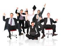 Glücklicher Geschäftsteamstuhl Stockfotos