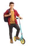Glücklicher Junge mit einem Roller Stockbild