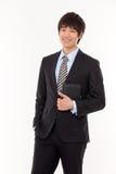 Glücklicher junger asiatischer Geschäftsmann Lizenzfreie Stockfotografie
