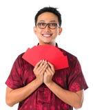 Glücklicher südostasiatischer chinesischer Mann Stockbild